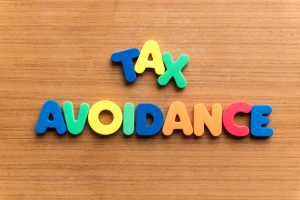 48499643 - tax avoidance colorful word on the wooden background