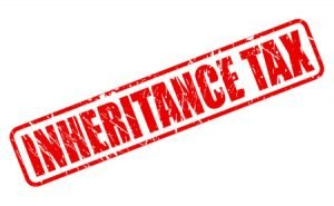 44717440 - inheritance tax red stamp text on white